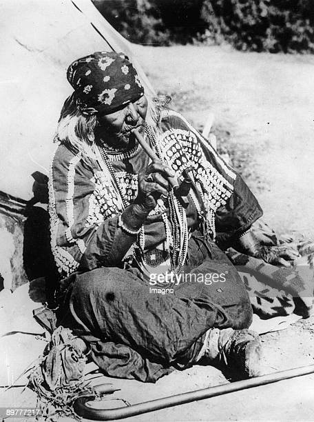 An old American Indian is smoking a pipe Photograph Around 1935