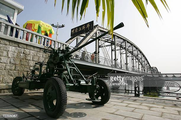 An old antiaircraft machinegun stands near the 'Broken Bridge' which was bombed by the US during the Korean war on October 18 2006 in the Chinese...