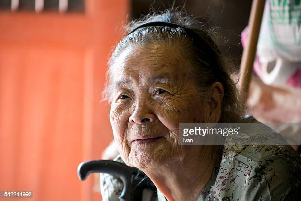 An Old Asian Woman, Grandma, Looking Up and With kindly and Anxious Eyes