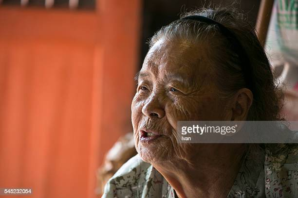 An Old Asian Woman, Grandma, Talking and Looking Right