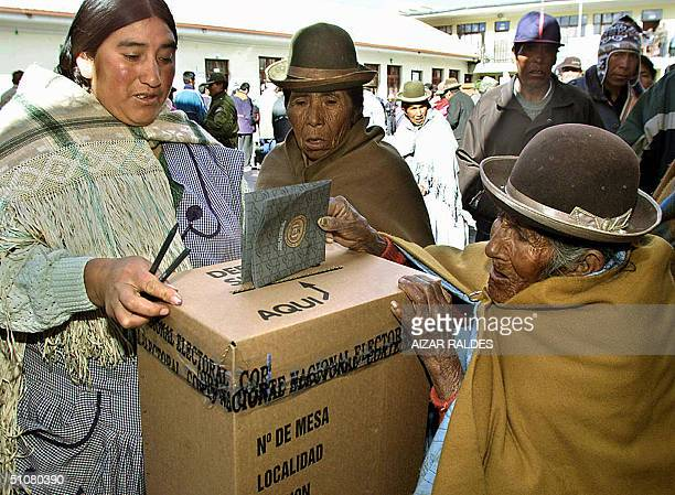 An old aymara native casts her ballot 18 July 2004 in Achacachi region of the Bolivian Altiplano, during the referendum about the nationalization of...