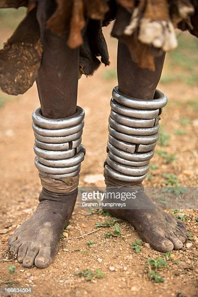 CONTENT] An old blind Hamar woman displays her leg bracelets which show how old she is Hamar women apply more leg bracelets the older they get