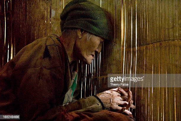 An old blind woman sits idle at a displaced people community in the jungle of the Northern Karen State For years the Burmese army has been leading...