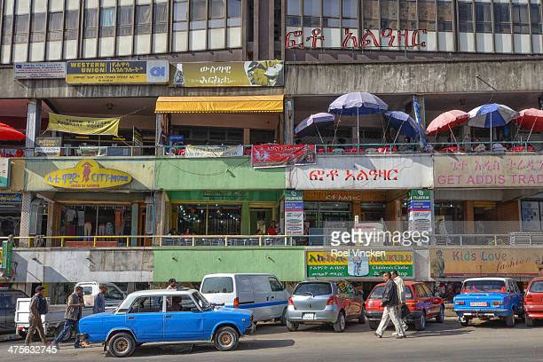 An old blue Lada Taxi parked in the typical Cunningham Street in the center of Addis Abeba.