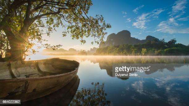 An old boat in Nhong Tha le Lake, Krabi ,Thailand in amazing dawn.