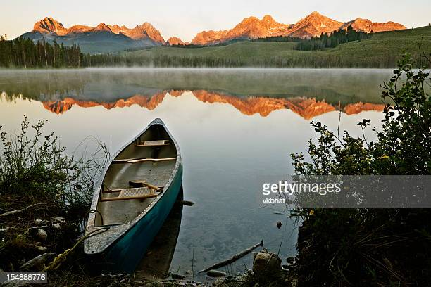 an old boat looking out into the sawtooth sunrise - idaho stock pictures, royalty-free photos & images
