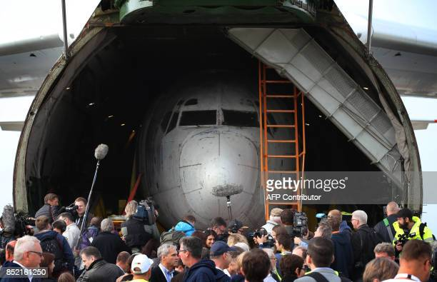 """An old Boeing 737 plane, the former """"Landshut"""" aircraft of German airline Lufthansa, is seen in the cargo space of an Antonov AN 124 cargo plane..."""