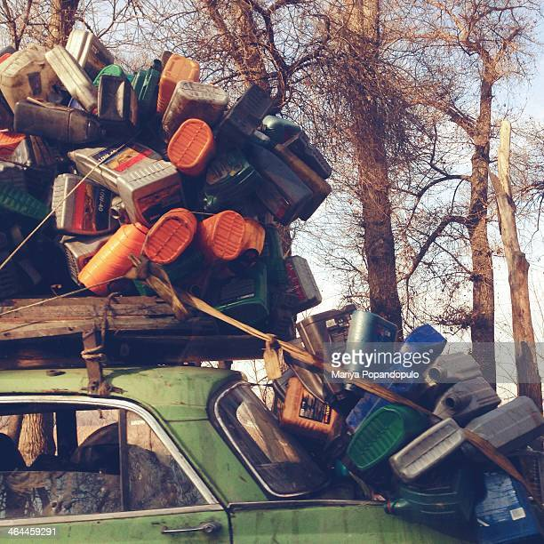 CONTENT] An old car driving with a lot of empty bottles stacked onto car Picture taken near Almaty Kazakhstan