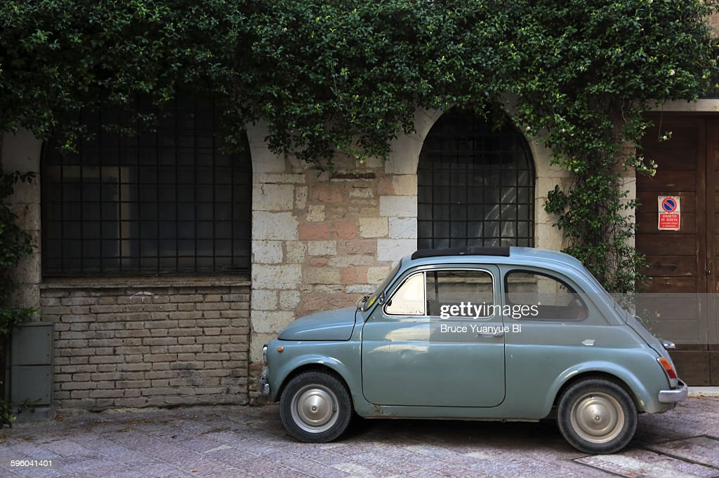 An old car parking on street of Assisi : Stock Photo