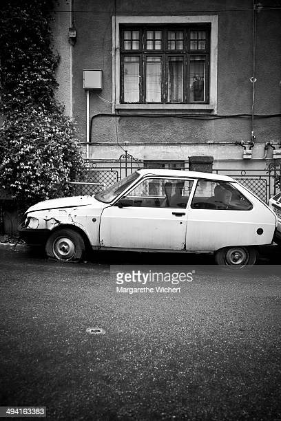 An old car with flat tires on June 2 2011 in Bucharest Romania