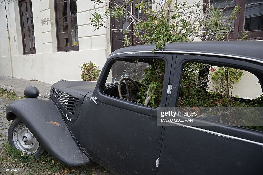 An old car with plants decorates the historic quarter section of ...
