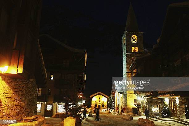An old church stands lit up February 12 2004 in the French ski resort of Val d'Isere
