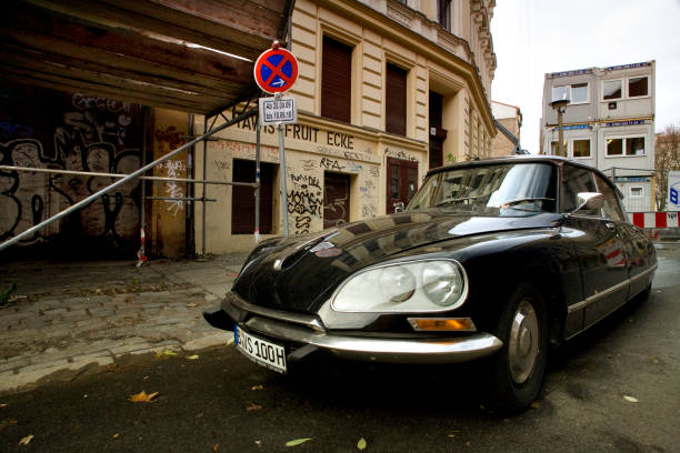 An old Citroen DS Pallas parked in front of old apartment buildings in the district of Prenzlauerberg, Berlin, Germany