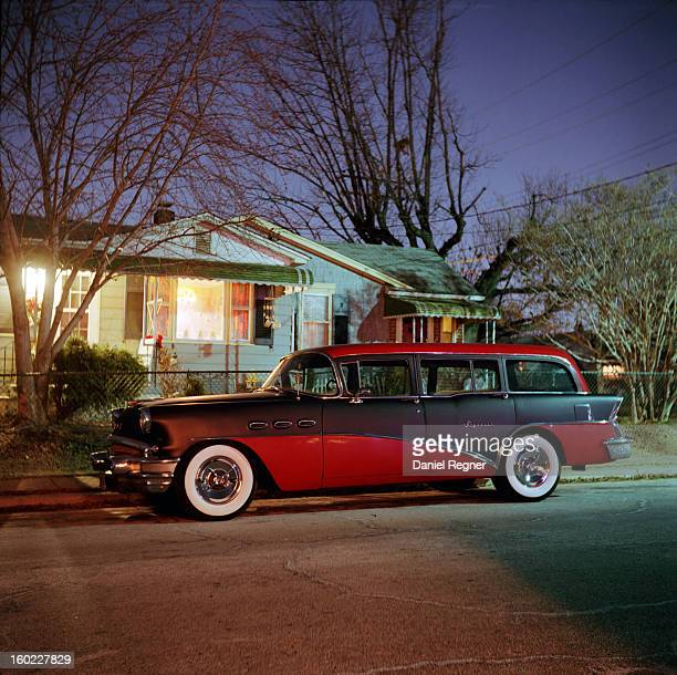 CONTENT] An old classic red station wagon can be seen parked outside of a typical suburban home on a nice clear evening