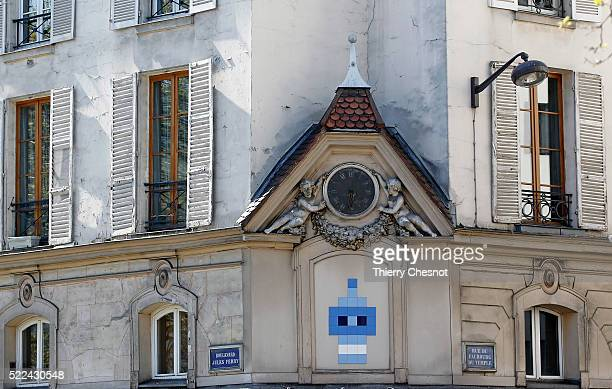 An old clock is seen on the corner of the rue Jules Ferry and rue Faubourg du Temple on April 18 2016 in Paris France This clock is located beside...
