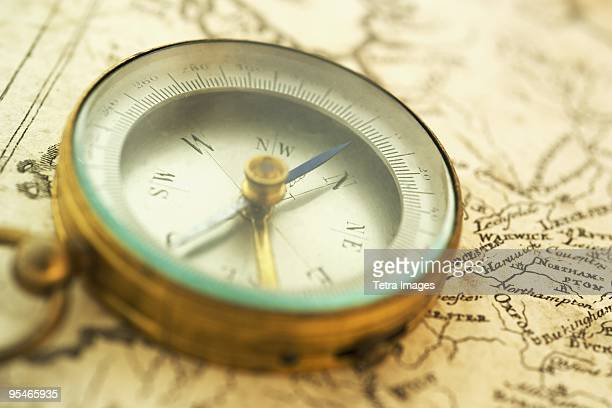 An old compass on a map