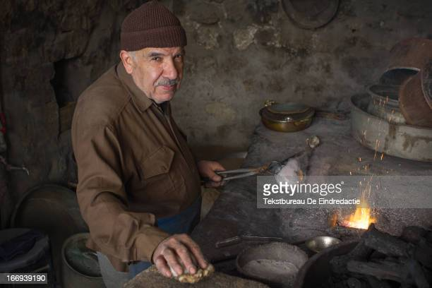 CONTENT] An old coppersmith practicing his ageold craft in his small workshop in the predominantly Kurdish town of Mardin southeastern Turkey