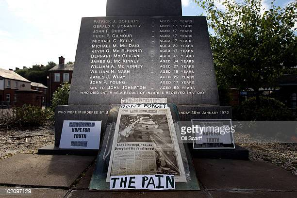 An old copy of The Derry Journal is placed at the foot of the memorial of the Bloody Sunday killings in the Bogside area of Londonderry on June 15...