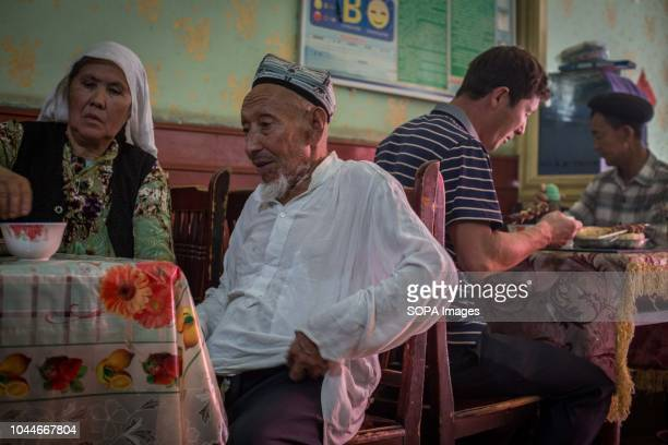 An old couple seen having lunch at a local restaurant in Keriya in the Hotan Prefecture Xinjiang Uyghur Autonomous Region in China Kashgar is located...