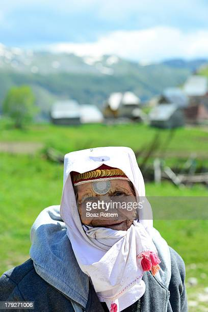 CONTENT] An old Dinaric highlander woman wearing traditional head wear and ornaments The coin is from the Ottoman empire