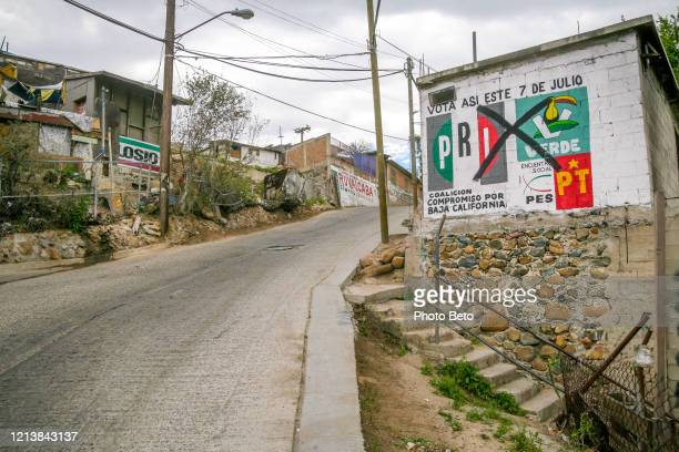an old election announcement in a street of lomas taurinas in tijuana - mexico murder stock pictures, royalty-free photos & images