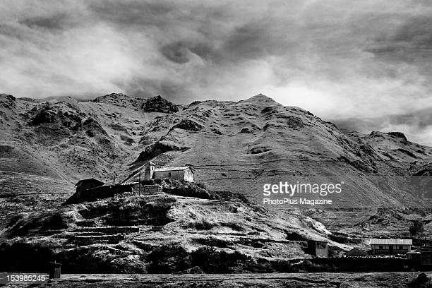 Image has been converted to black and white An old farmhouse situated on a rocky hillside in England on September 10 2011