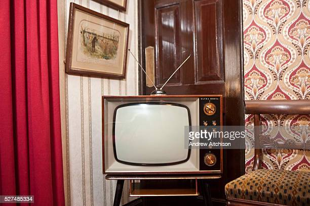 An old fashioned analogue television set in a home in the UK. These old TV models are nearly obsolete. British television has now moved to digital...