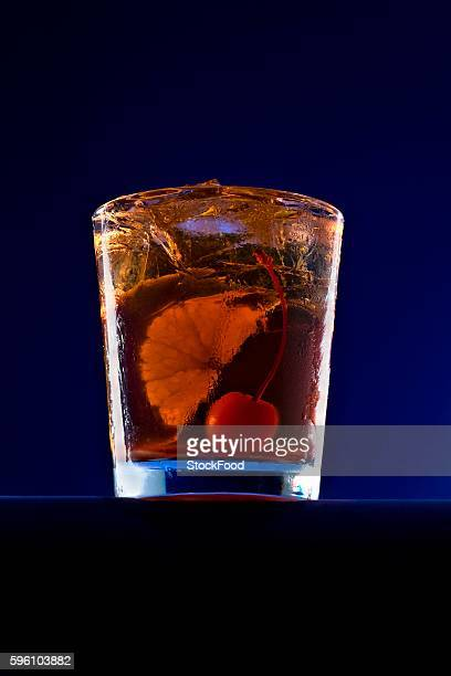 An Old Fashioned Cocktail with an Orange Slice and a Cherry