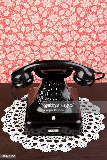 an old fashioned telephone on a dresser - doily bildbanksfoton och bilder