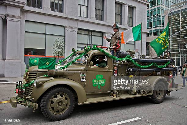 An old fire truck decorated for St. Patrick's Day participates in the annual parade on Market Street, San Francisco.