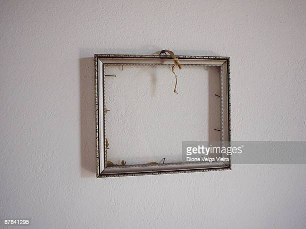 An old frame without the picture on the wall