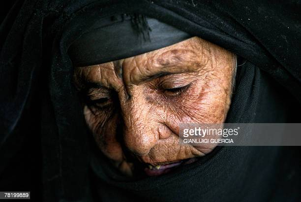 An old Iraqi woman looks down as US soldiers from the 1st Battallion 38 Infantry reagiment strikers brigade deploy during the air assault operation...