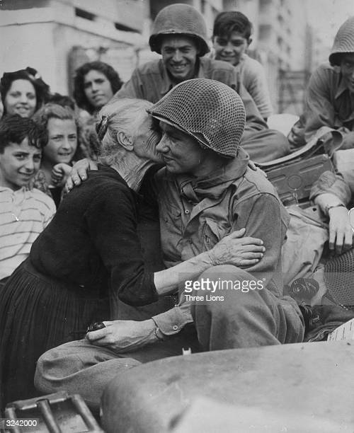 An old Italian woman shows her gratitude to one of the American soldiers following the liberation of Italy.