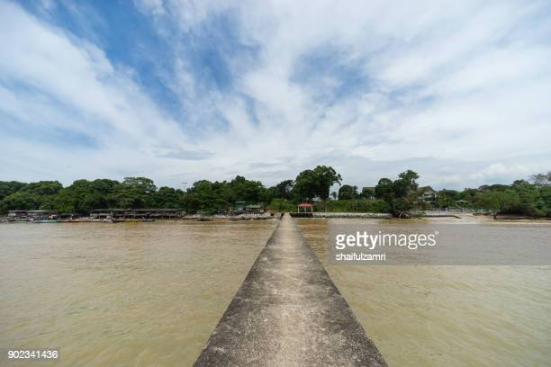 PORT DICKSON, MALAYSIA - 24TH DEC 2017; An old jetty on the still water at Port Dickson, Malaysia stretches towards to horizon