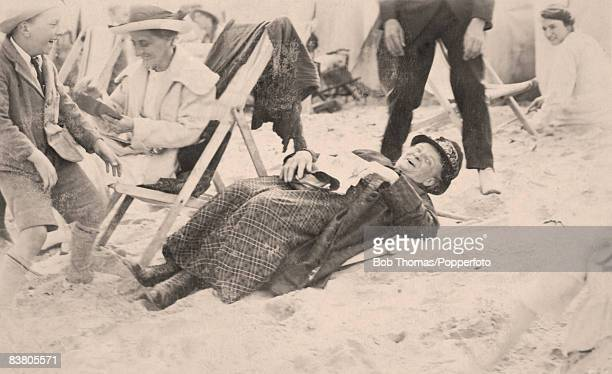 An old lady laughing after her deckchair had collapsed on the beach in Margate 14th September 1921