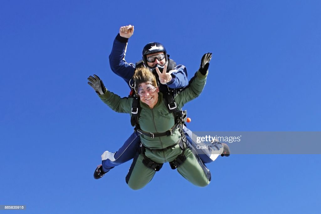 An old lady practicing skydiving : Stock Photo