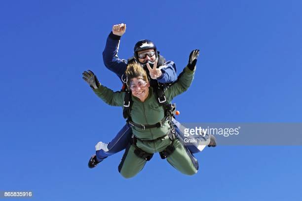 An old lady practicing skydiving