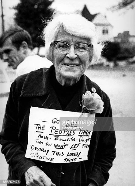 An old lady with a sign asks people to see People's Park circa May 1969 in Berkeley California