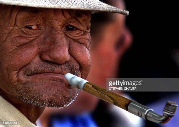 an-old-man-about-to-smoke-his-tobacco-pi