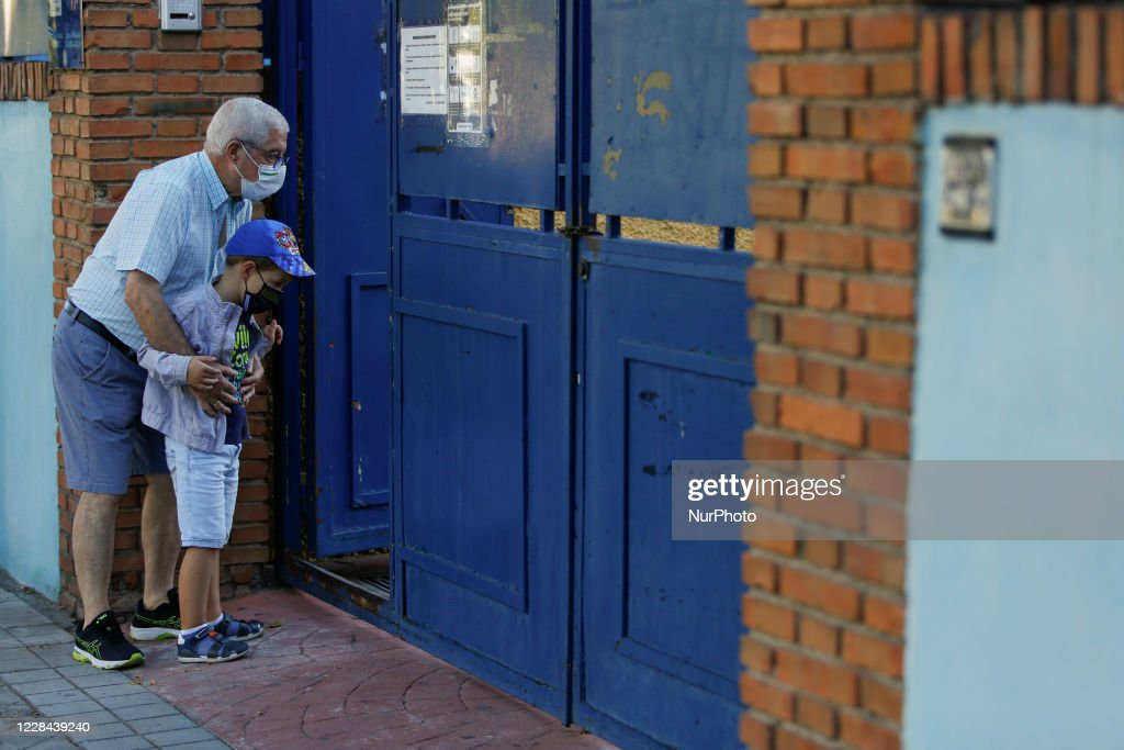An old man and his grandchild wearing facemasks during the first day...  News Photo - Getty Images