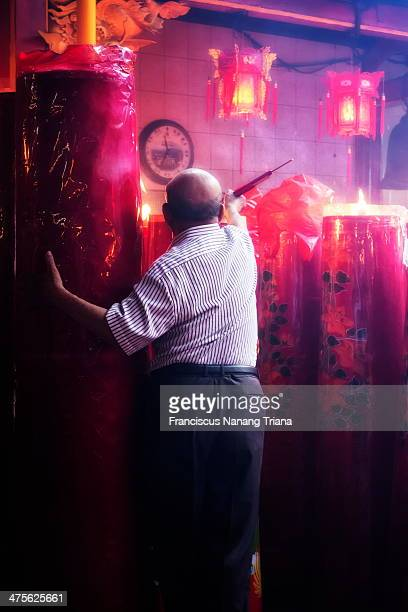 CONTENT] An old Man burn the myrrh from big candle during Chinese New Year31st January 2014 at Dharma Bhakti temple Glodok Jakarta the eldest Chinese...
