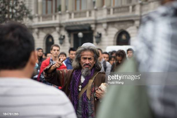 An old man gives a speech during the protest against corruption before independent day of Peru, on July 27 2013, in Plaza de 2 de Mayo , Lima, Peru.
