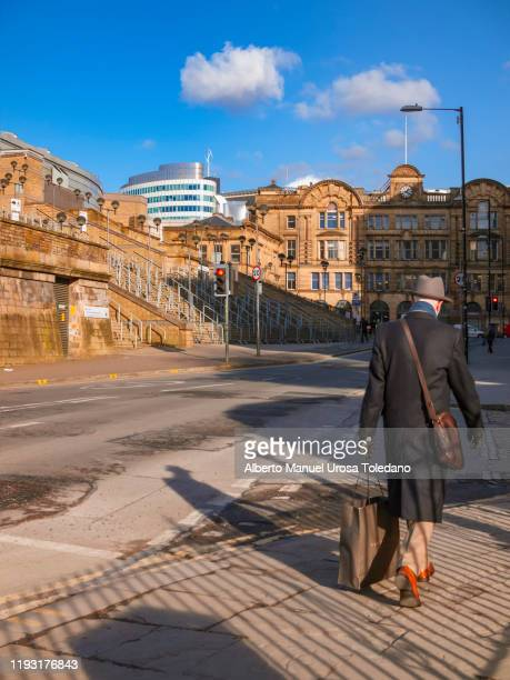an old man going to victoria train station - victoria station manchester stock pictures, royalty-free photos & images