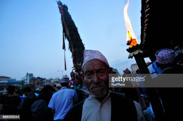 An old man hold oil torch during celebration of Bhoto Jatra festival at Jawalakhel Patan Nepal on Thursday May 25 2017 Rato Machindranath is also...