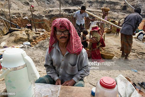 An old man is selling tea and cigarette at the stone extraction site in Jaflong Sylhet Bangladesh on February 28 2015 Sylhet is a very resourceful...