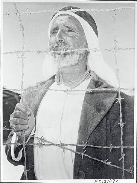 Arab Man Behind a Barbed Wire on Gaza Strip Pictures | Getty Images