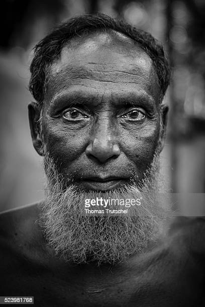 An old man posing for a photo in a rural region in the southwest of Bangladesh on April 10 2016 in Betal Para Bangladesh
