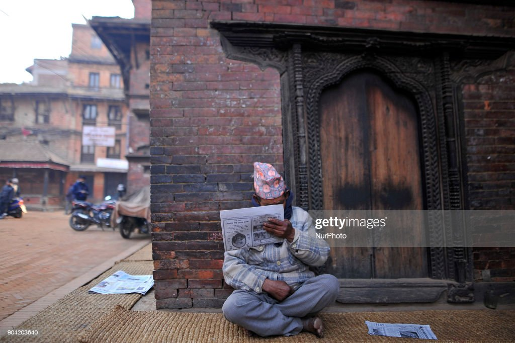 An old man reading daily newspaper at Bhaktapur, Nepal on Friday, January 12, 2018.