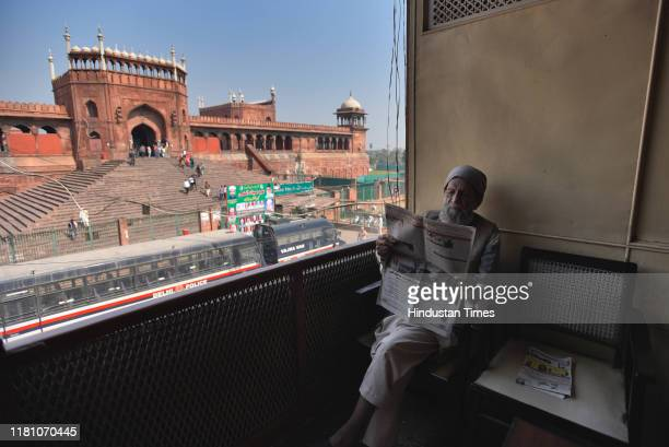 An old man reads a newspaper on the day of the Supreme Court verdict in the Ram Janmabhoomi Babri Masjid case at Jama Masjid on November 8 2019 in...
