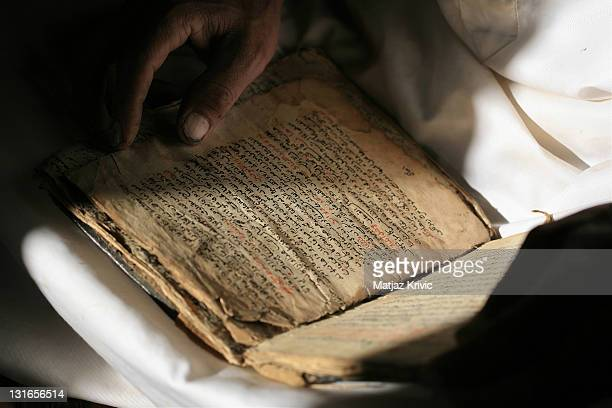 An old man reads the Holy Koran in his home situated on the Shugruf moutain on January 24 2006 in Shugruf Yemen Decades of political unrest in the...